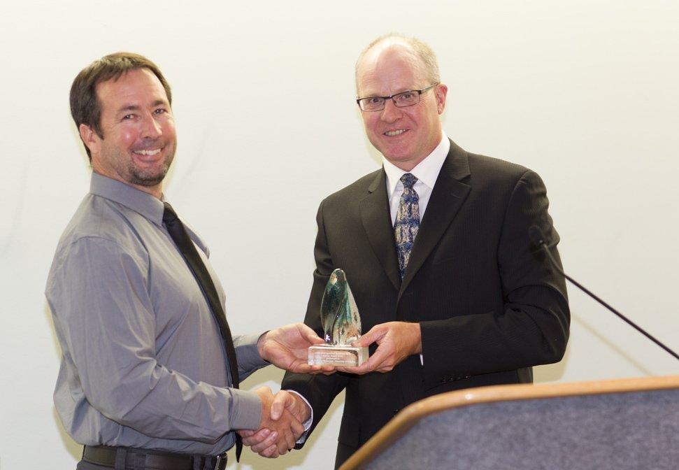 Greg McDermid receiving his award
