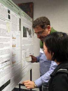 BERA collaborators Dr. Guillermo Castilla, from Natural Resources Canada, and Shijuan Chen, from the University of Calgary, discuss a research poster.